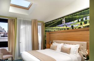 Lova arba lovos apgyvendinimo įstaigoje Jardins de Mademoiselle Hôtel & Spa