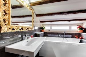 Um banheiro em Hotel New Reiter