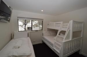 A bunk bed or bunk beds in a room at Mowamba A1