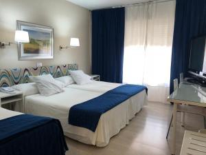 Cama o camas de una habitación en Hotel Virrey