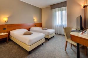 Кровать или кровати в номере Best Western Hotel Turismo