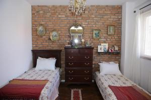 A bed or beds in a room at Apartment Nesti in Pristina Kosovo