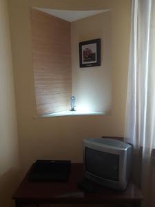 Телевізор і / або розважальний центр в Комната в квартире