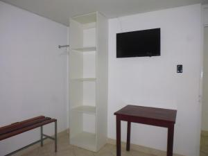 A television and/or entertainment centre at Hostal Fatima