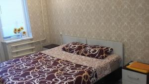 A bed or beds in a room at Apartment Zvezdnaya 8