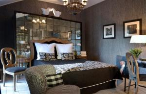 מיטה או מיטות בחדר ב-Hôtel St Pierre