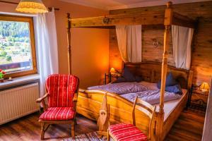 Ein Bett oder Betten in einem Zimmer der Unterkunft Gästehaus Riedl