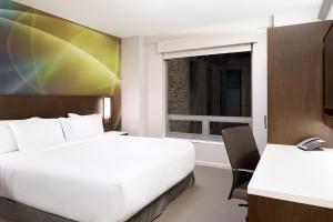 Ein Bett oder Betten in einem Zimmer der Unterkunft LUMA Hotel - Times Square