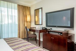 A television and/or entertainment center at Hotel Gloria