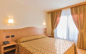 Letto o letti in una camera di Hotel Residence 3 Signori
