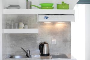 Η κουζίνα ή μικρή κουζίνα στο Naxos Colosseo