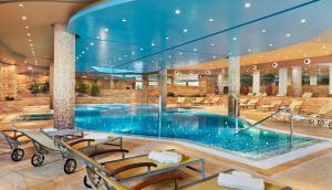 The swimming pool at or near H10 Playa Meloneras Palace
