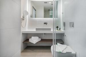 Ένα μπάνιο στο Hotel Palmyra