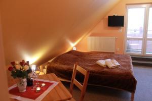 Łóżko lub łóżka w pokoju w obiekcie Pensjonat i Restauracja Nowak