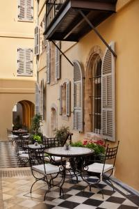 A porch or other outdoor area at The Drisco – The Leading Hotels of The World