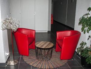 Coin salon dans l'établissement City Lodge Appart Hôtel Niort