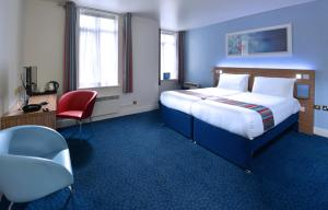 A bed or beds in a room at Travelodge Dublin City Rathmines