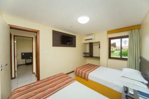 A bed or beds in a room at Makai Resort All Inclusive Convention Aracaju