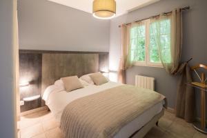 Un ou plusieurs lits dans un hébergement de l'établissement Les Collines Iduki