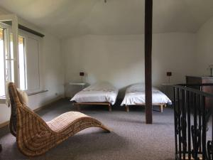 """A bed or beds in a room at Holiday Home """"Les Ancolies """" Gîte citadin"""