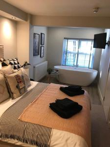 A bed or beds in a room at number 26