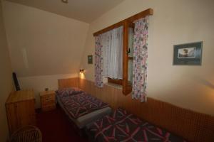 Postel nebo postele na pokoji v ubytování Holiday home Kovarov/Lipno-Stausee 1942