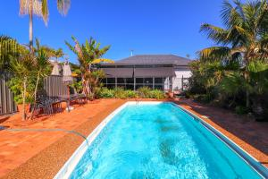 The swimming pool at or near Blacksmiths Sea Breeze