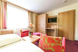 Postel nebo postele na pokoji v ubytování Hotel Schladmingerhof