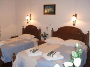 A bed or beds in a room at Residencial Dandy