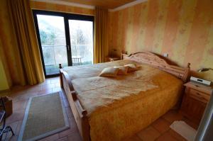 Ein Bett oder Betten in einem Zimmer der Unterkunft Landhotel Maarheide