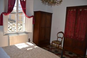 A bed or beds in a room at La Casa di Antonella