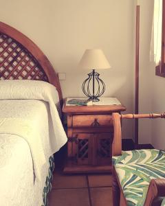 A bed or beds in a room at Posada Las Garzas
