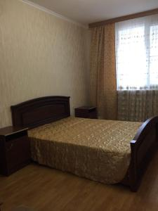 Кровать или кровати в номере Apartment Rakhmaninova