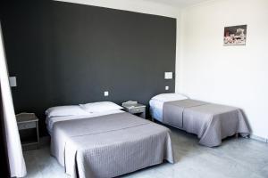 Un ou plusieurs lits dans un hébergement de l'établissement Hotel U Casone