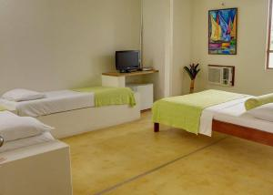 A bed or beds in a room at Hotel Lagos de Menegua