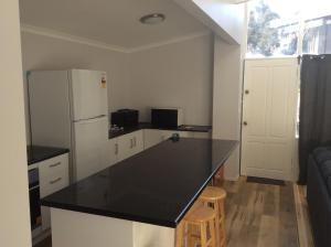 A kitchen or kitchenette at Alpha Centauri Townhouses