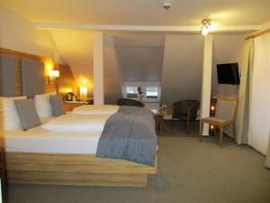 Ein Bett oder Betten in einem Zimmer der Unterkunft Hotel Stadt Hamburg