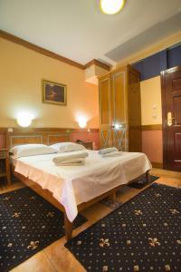 Krevet ili kreveti u jedinici u okviru objekta Garni Hotel Zenit