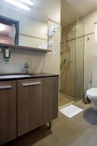 Kupatilo u objektu Garni Hotel Zenit