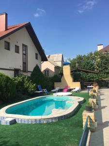 The swimming pool at or near Daniil Guest House