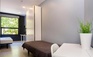 A bed or beds in a room at Barna House Hotel