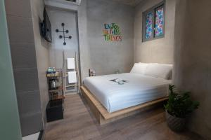 A bed or beds in a room at 9 Hostel and Bar