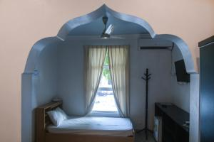 A bed or beds in a room at Azoush Tourist Guesthouse