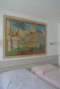 A bed or beds in a room at Les Alpes