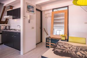 A kitchen or kitchenette at Apartment Step by Step