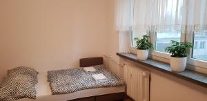 Łóżko lub łóżka w pokoju w obiekcie Apartament Aga1