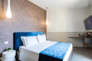 Un ou plusieurs lits dans un hébergement de l'établissement A World Aparts - Barberini Boutique Hotel