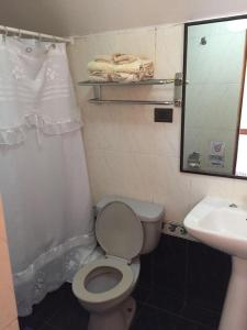Un baño de Apart Hotel Brisas del Mar