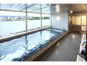 The swimming pool at or near Y's Hotel Asahikawa Ekimae