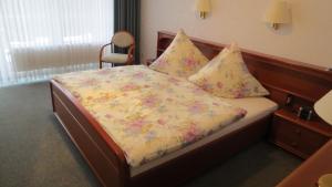 Ein Bett oder Betten in einem Zimmer der Unterkunft Hotel Albatros